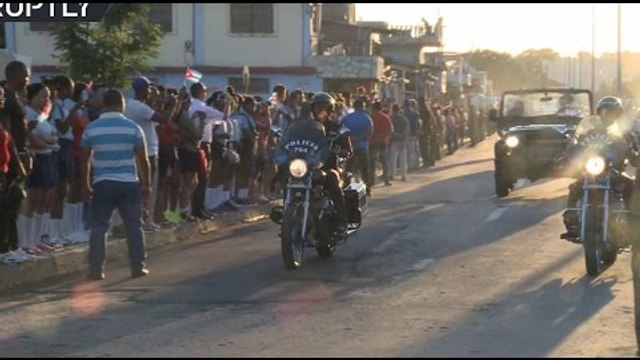 Thousands of Cubans line Santiago streets to pay their respects as Castro's ashes interred privately