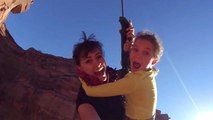 Young Girl Rope Swings Into Canyon