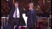 Quand Brigitte Macron, très émue, rejoint son mari sur scène au Louvre