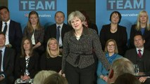 May defends energy prices cap