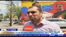 Venezolanos residenciados en EE. UU. lanzan pintura blanca sobre un mural de Hugo Chávez en el Bronx