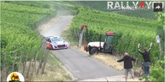 Rally car almost crash with a tractor