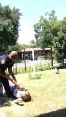 Mom attacked by cops in front of her children
