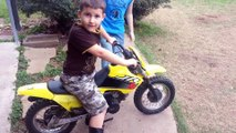 Little kid runs staight into fence with dirt bike