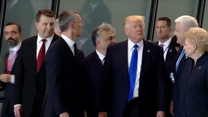 Donald Trump PUSHES The Prime Minister Of Montenegro To Be In Front of Group (VIDEO)