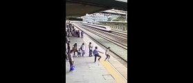 Heart-stopping - Suicidal woman saved at last second from approaching train in China