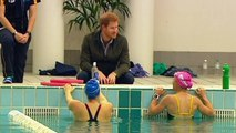Beaming Prince Harry spends time with injured veterans