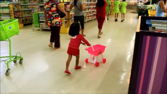 Baby Doing Grocery Shopping at Supermarket with Toy Shopping Cart - Donna The