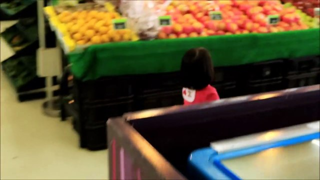 Baby Doing Grocery Shopping at Supermarket with Toy Shopping Cart - Donna Th