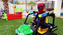 Batman and Spiderman Save House on Fire Driving John Deere Gator and Power Wheels with Wat