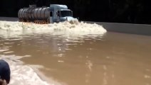 Truck Crossing on Extreme Heavy River Flo