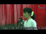 Aung San Suu Kyi holds press conference in Rangoon.