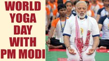 PM Modi braves rain to attend World Yoga day in Lucknow with 51,000 participants | Oneindia News