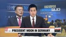 President Moon arrives in Germany, encourages Korean community