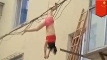 Defying Death: Woman dangles from power line in underwear after nearly falling to death - TomoNews