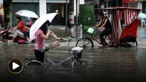 Heavy rain in Southern China causes floods, killing 56