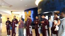 Michigan great Cazzie Russell shows the Armstrong State basketball team the house that he