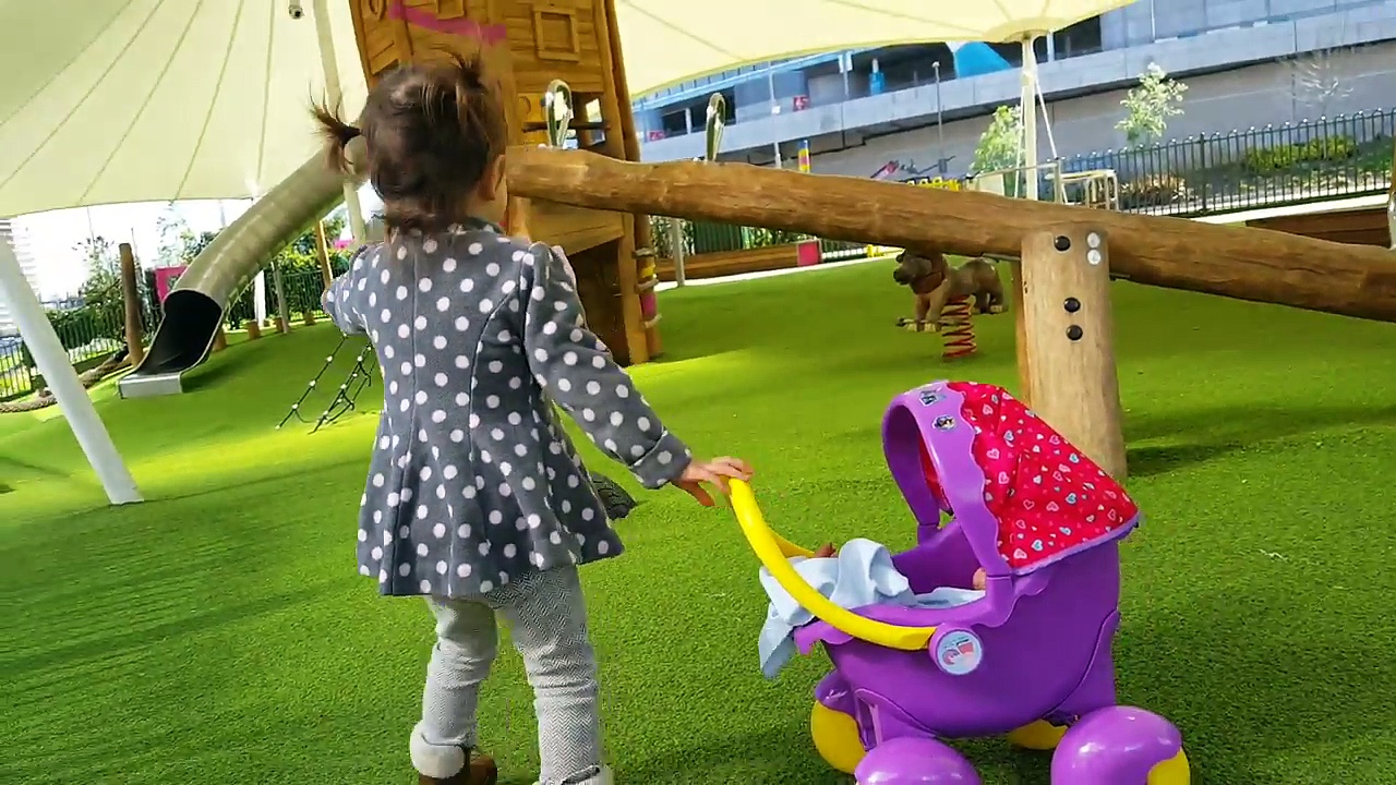 Little Girl Pushing Peppa Pig Stroller / Playground / Having Fun with Baby Doll
