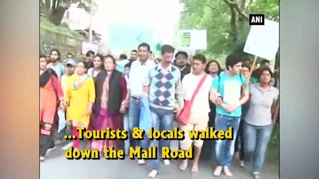 Tourists, locals take out foot march to preserve Naini Lake