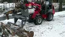 Device for chopping firewood on a mini loader