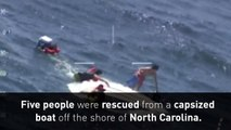Coast Guard rescues five from capsized boat
