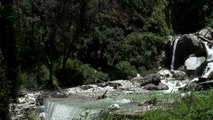 Crossing a raging Himalayan torrent by car- monsoon in the mountains
