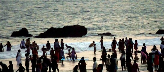 Tourists cluster on shore of Rama Krishna Beach in Andhra Pradesh