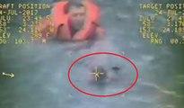 Le capitaine d'un bateau saute dans l'eau glacée pour sauver un pêcheur en train de se noyer