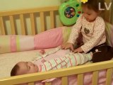 Amazing !! 20 month old trying to change her 5 month old baby sisters diaper!!