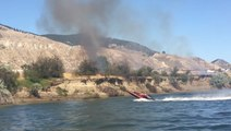 Speedboat Creates Waves to Douse British Columbia Wildfire