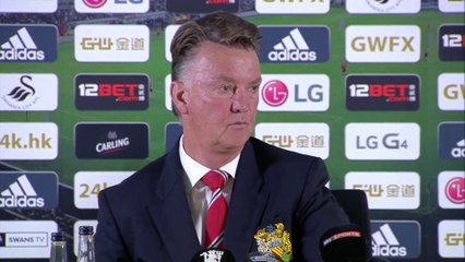 Manchester United manager Louis van Gaal walks out of press conference