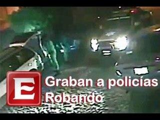 Graban a policías robando en Querétaro