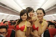 Sexy Air Hostesses Doing a Bikini Show For Passengers On Board