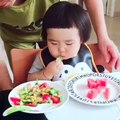 3 year old chines  kid eat one watermill on  complete