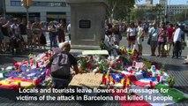 Barcelona: Mourners lay flowers at Plaza de Catalunya