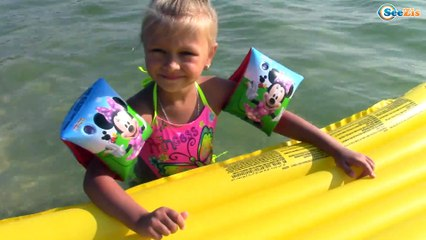 Bad Baby with Inflatable Сolored Mattresses on the water Family Fun Playtime Activity