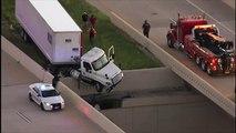 Ce camion semi-remorque est coincé au-dessus du vide sur l'autoroute !