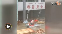 Man saves two from getting swept away by floods in Macau