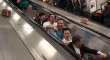 Guys Pretend To Row Up Escalator