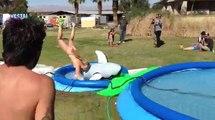 Girl Goes Off A Slip-N-Slide Jump And Loses Bikini
