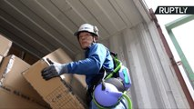 Japanese Shipyard Workers Use Robotic Exoskeleton to Help with Heavy Lifting