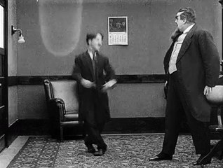 Charlie Chaplin and Eric Campbell in The Floorwalker (1916)