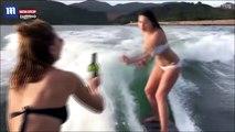 Une fille sexy tombe en surf mais parvient à sauver sa bouteille de vin, la vidéo buzz