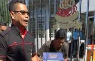 Red shirt leader Jamal Yunos smashes crates of beer at SUK entrance