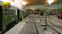 Cab ride on a model railroad display with Marklin and Kiss and KM1 steam trains