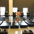 Gym Enthusiast Prepares for Competition Using Multiple Treadmills