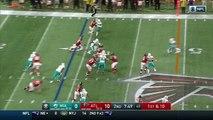 Atlanta Falcons running back Devonta Freeman weaves through Dolphins defenders on 44-yard gain