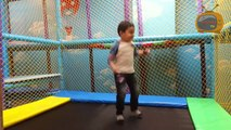 Happy Kid Jumping And Playing With Trampoline, Slides, Cars, Swings And More