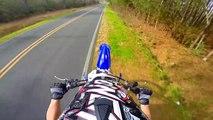Dirt bike runs from cop after wheelie