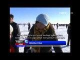 NET5 - Memancing di danau berselimut Es